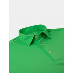 Green Solid Pique Performance Polo Laying Flat